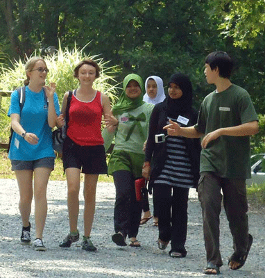 International youth walk together during afternoon break